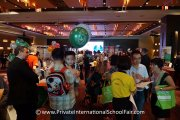 A happy boy with his Straits International School balloon at the fair