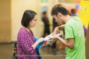 A parent scouring the latest edition of the Education Destination Malaysia guidebook