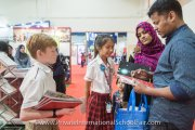 HELP International School student representatives speaking to parents