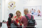 A Kingsgate International School representative speaking to parents
