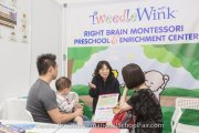 Learning more about right brain montessori at Tweedlewink's booth