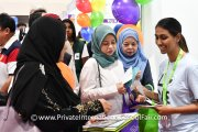 Visitors at the Early Autism Project booth