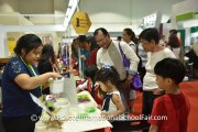 Visitors at Beebop Circus booth