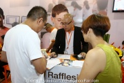 Parents enquiring at the Rafflesia International & Private Schools booth