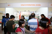 Parents enquiring at the Straits International School booth