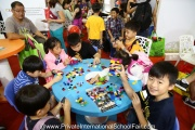 Kids occupied with LEGO activities at the fair