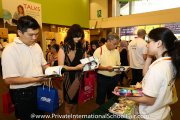 Visitors browsing through the latest edition of the Education Destination Malaysia guidebook