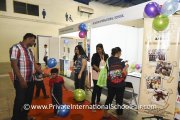 Visitors at the Al-Noor International School booth