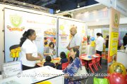 A Bukit Bintang Pre-school representative chatting to a visitor