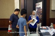 A representative from Labuan International School talking to parents