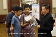 Parents speaking to a school representative from Epsom College Malaysia