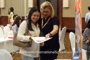 A parent finding out more about international school education at Raffles American School