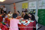 Interested visitors at the Sayfol International School table