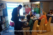 Visitors at the Prince of Wales Island International School table