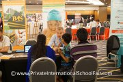 A family finding out what Raffles American School has to offer