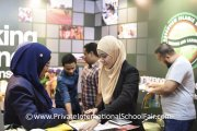 A parent finding out what Greenview Islamic School has to offer