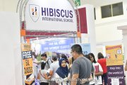 Parents speaking to a representative from Hibiscus International School