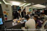 Hua Xia International School  representatives engaging with parents