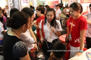 Exhibitors explaining to parents and visitors