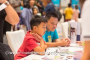 Dad and son at an exhibitor's table