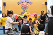 Kids interacting with each other at the Kingsley International School performing arts workshop