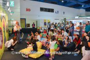 Children having fun watching Uncle Billy as he presents a show involving puppets, games and balloons sculpture