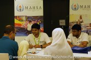 Visitors gaining information at the MAHSA International School table