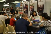 Visitors speaking to Universal Hua Xia International School (Penang) representatives