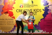 Mint Director Nickie Yew with the 6 year old prize winner from Category A
