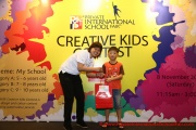 Mint Director Nickie Yew with the 7 year old prize winner from Category B