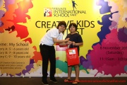 Mint Director Nickie Yew with the 8 year old prize winner from Category B