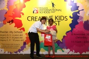Mint Director Nickie Yew with a 9 year old prize winner from Category C