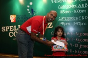 Mr Raajsh Kumar from MPH Bookstores giving out the consolation prizes to a participant from Category A