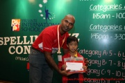 Mr Raajsh Kumar from MPH Bookstores giving out the consolation prizes to a participant from Category B