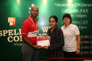 Mr Raajsh Kumar from MPH Bookstores giving out the consolation prizes to a participant from Category C