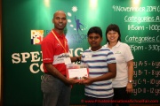 Mr Raajsh Kumar from MPH Bookstores giving out the consolation prizes to a participant from Category D