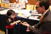 A child interacting with a school rep
