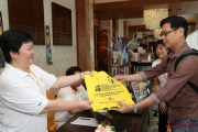 A parent receiving the complimentary goody bag