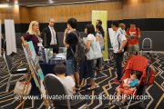 Families enquiring about an international school education at the Dover Court International School table