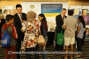 Prince of Wales Island International School representatives engaging with visitors