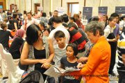 A parent finding out what Raffles American School has to offer
