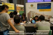 Interested parents at the Prince of Wales Island International School table