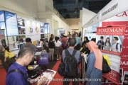 Visitors at the Portman Academy booth