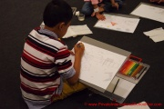 A participant deeply engrossed in his drawing