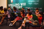 Participants taking their turn at spelling the words