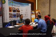 Visitors speaking to a representative from International Islamic School Malaysia