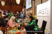 A parent finding out what Aster International Preschool has to offer