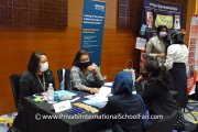 Representatives from Newcastle University Medicine Malaysia speaking with visitors