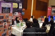 Representatives from Sribagan International School speaking with visitors