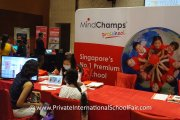 A MindChamp Preschool representative speaking with visitors